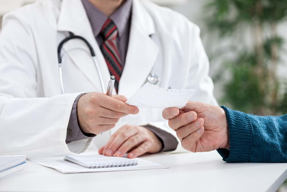 doctor giving HGH prescription